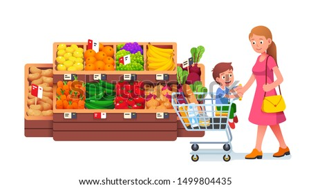 Single mother push full shopping cart with son kid sitting in trolley walking in supermarket fruit & vegetables groceries produce aisle. Mom & child family in grocery store flat vector illustration