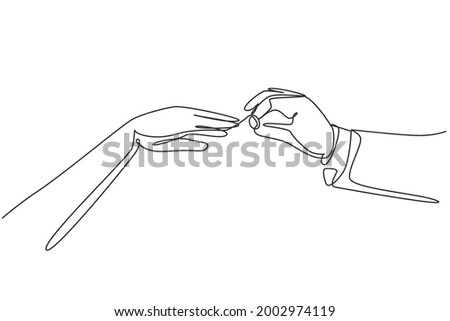 Single one line drawing groom puts ring on finger of bride. Bride and groom make vow of loyalty on their wedding day. Marriage ceremony celebration concept. Modern continuous line draw design graphic Photo stock ©