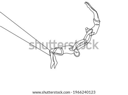 Single one line drawing two acrobatic players in action on a trapeze with a male player hanging from his two legs while catching a female player. One line draw design graphic vector illustration. Stockfoto ©