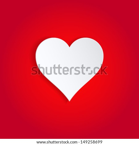 single white paper heart on red