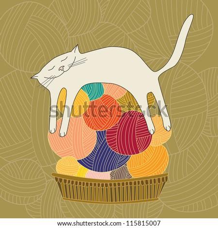 sleeping white cat on the yarn