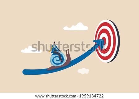 Slow business progress, laziness or procrastination, unproductive or efficiency concept, tried businessman riding snail slow walking on arrow to reach target. Сток-фото ©