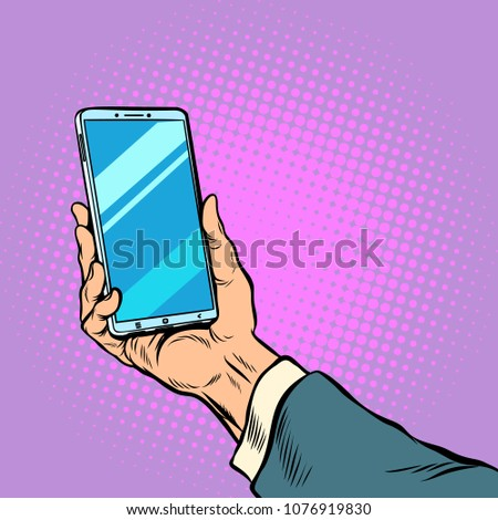 Smartphone in male hand selfie. Pop art retro vector illustration comic cartoon kitsch drawing