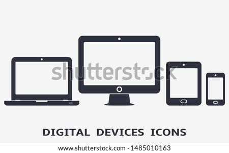 Smartphone, tablet, laptop and desktop computer icons. Vector illustration of responsive web design.