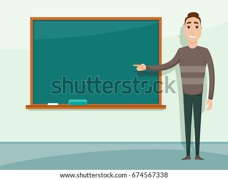 Smiling teacher standing in front of blackboard. Teacher teaching student in classroom at school, college or university.