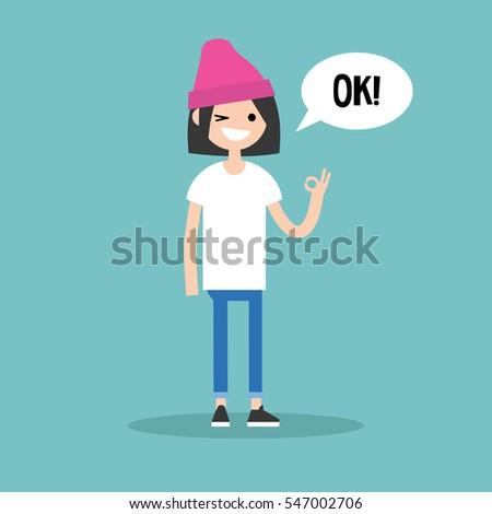 """Smiling winking brunette girl says """"ok"""" / Flat vector illustration, clip art #547002706"""