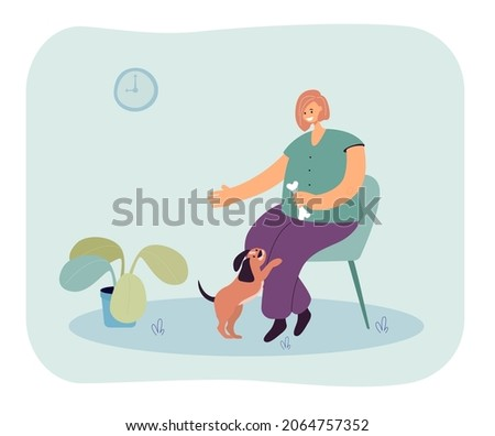 Smiling woman sitting on chair and holding bone for her dog. Young female playing with pet flat vector illustration. Friendship, pet love and care concept for banner, website design, landing web page