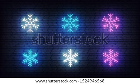 Snow icons neon. Vector glowing neon colorful snowflake icons