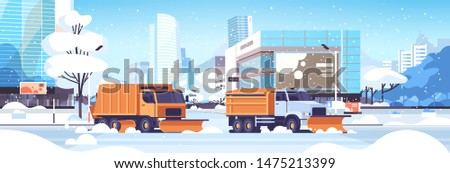 snow plow trucks cleaning road