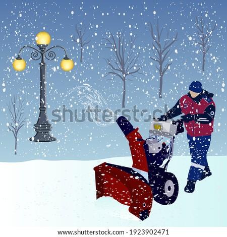 snowblower  worker in overalls