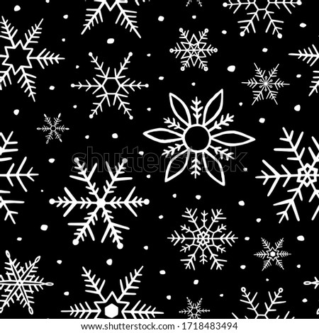 Snowflakes seamless pattern. Snowflake background. Winter design for prints. Handdrawn snow. Hand drawn falling snowflakes. Winter season. Black and white texture. Repeating snow flakes outlined