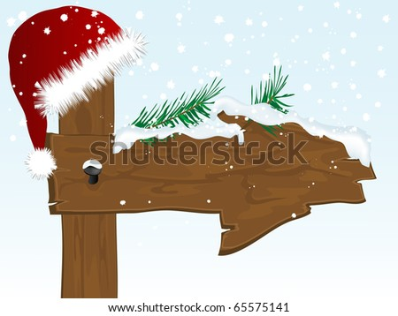 Snowy wooden arrow with Santa?s hat