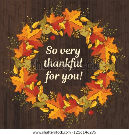 So very thankful for you. Template for Thanksgiving design. Colorful autumn leaves and text at dark wood background Сток-фото ©