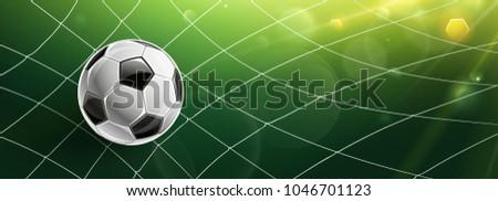 soccer ball in goal of bright