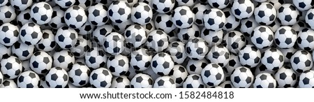 Soccer balls background. Heap of classic black and white soccer balls. Realistic vector background
