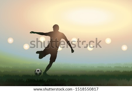 soccer player is kicking a ball