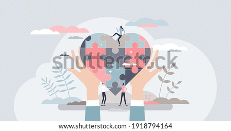 Social care with jigsaw pieces heart as charity and help tiny person concept. Elder and poor support with donations assistance and kindness vector illustration. Autism unity and solidarity awareness.