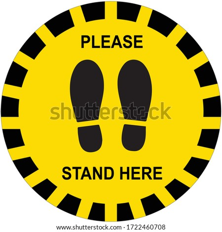 Social distancing concept for preventing coronavirus covid-19 with black footprint and wording please stand here in yellow-black tape sign