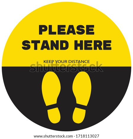Social distancing concept for preventing coronavirus covid-19 with wording Please stand here and footprint on yellow-black circle background