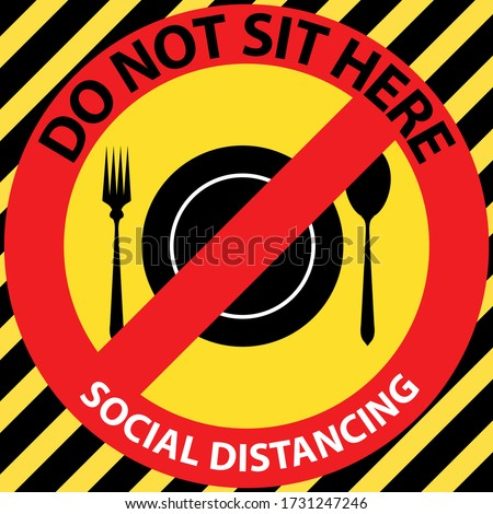 Social distancing seating signs for eating. Do not sit here to prevent from Corona virus or Covid-19 pandemic. Keep distance 6 feet for table, chair, seat in canteen, cafeteria, restaurant, food court