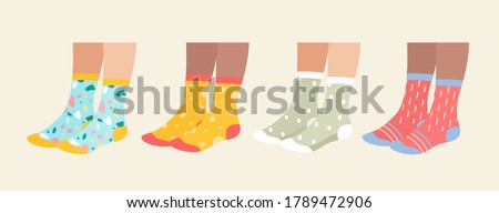Socks on legs vector illustration set. Cartoon flat collection of underwear accessories, sock pair with colorful ornament, print and pattern, funny warm socks footwear isolated on white.