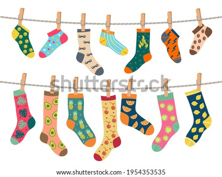 Socks on rope. Warm clothes with funny patterns comfortable socks laundry service recent vector concept picture