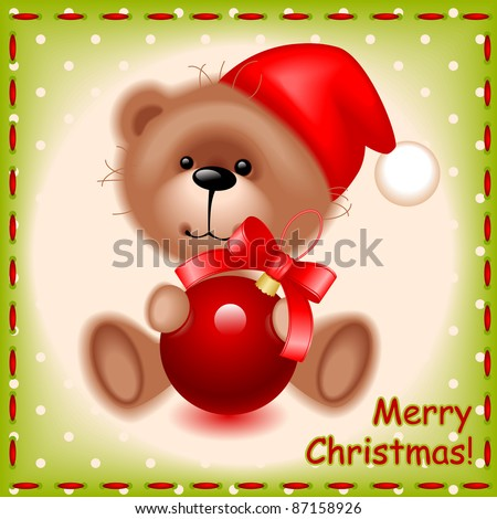 soft teddy toy bear with a Christmas ball on the background of the sewing texture