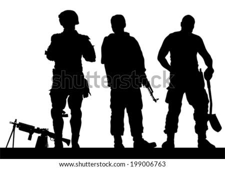 soldier in uniform with gun on