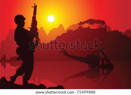 Soldier with crashed helicopter on the background