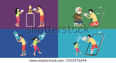 SONGKRAN, Thailand Water Festival in pandemic period, people should wear masks and keep physical distancing, they sprinkle water onto Buddha image and elder, they splash virtual water via smartphone