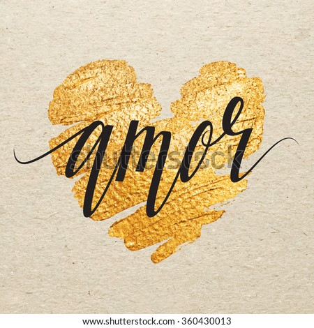 Shutterstock Spanish Valentines day card. Amor calligraphy lettering with gold paint heart on craft background. Hand drawn letters.