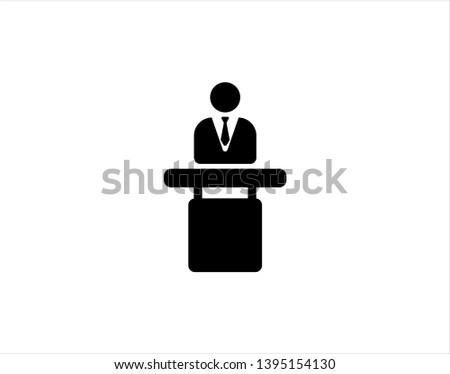 speaker black icon. orator speaking from tribune vector illustration - Vector
