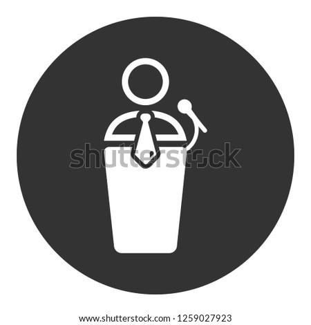 Speaker man vector icon. Podium speech sign. Conference presentation speech icon. Tribune orator speech sign. Audience spokesman symbol. EPS 10 flat symbol. Round social icon design