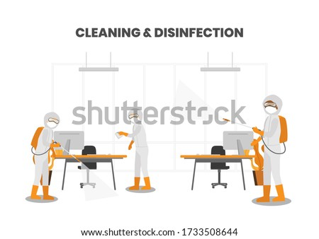 Specialists wear protective face masks and PPE suit, deep cleaning regimen includes biohazard disinfectant on all surfaces in office workspace COVID-19 outbreak prevention.