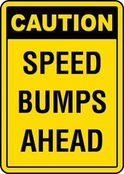 Speed bump ahead warning sign