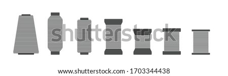 Spool and bobbin silhouette icon vector illustration. Black bobbin silhouette with outline needle isolated on white background. Machinery spool instrument, fashion logo graphic, tailor craft equipment