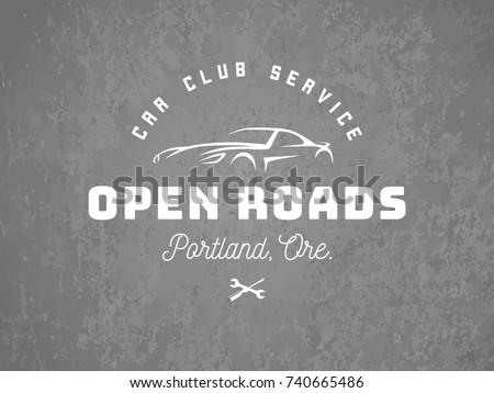 sports car logo on grunge grey