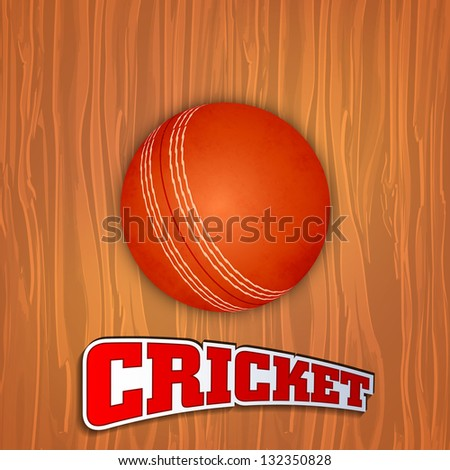 Sports concept with shiny red ball and text cricket on wooden background.