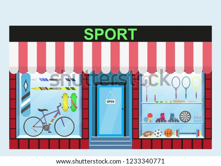 Sports shop. Shop window, range of products such as bicycles, skis, barbells, dumbbells, skateboards, rackets, balls, Darts and others.