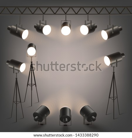 Spotlights or professional photo studio lamps of various shapes and sizes, hanging and standing on the base 3d realistic vector illustration. Stage or podium illumination scene.
