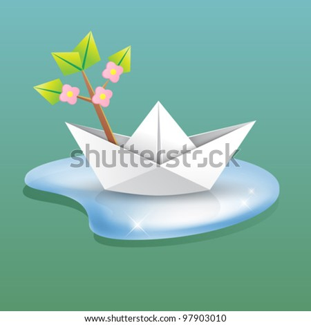 spring background concept - paper ship in a water with a blossom branch - origami creative design element