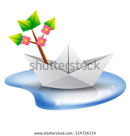 Spring is coming! Paper boat with a blossom tree branch aboard sailing in a puddle