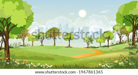 Spring landscape at city park in the morning, Natural public park with flowers blooming in the garden, Peaceful scene of green fields with blurry cityscape building, cloudy and sun on summer Stock photo ©