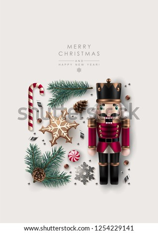 Square Christmas Composition made of Pine Branches, Snowflakes, Confetti, Cookie, Candy Cane and Nutcracker . Flat lay, top view.