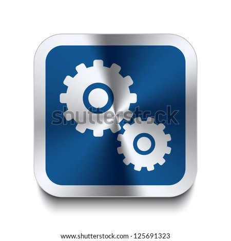 Square metal button with gear icon print on top of it. Part of a collection of blue metal buttons.