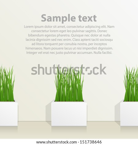 square pot with grass against