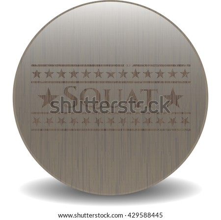 Squat badge with wooden background