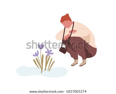 Squatting man admiring first spring flower or snowdrop. Teenager with camera sitting and looking at primrose. Flat vector cartoon illustration isolated on white background Stock photo ©