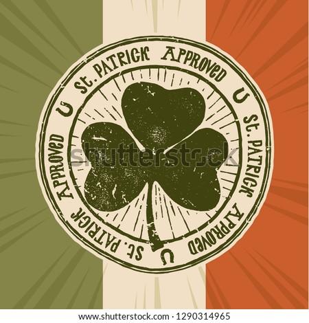 St. Patrick approved - vintage shamrock stamp - typography illustration on irish flag background