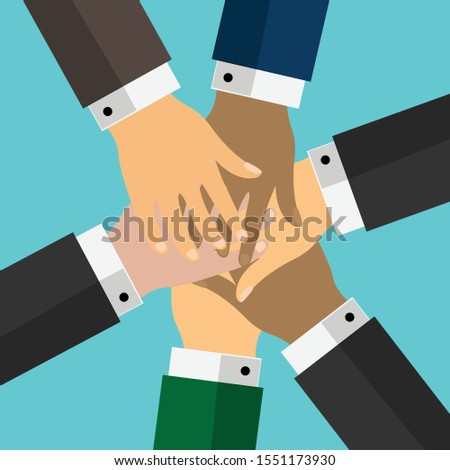 Stack of hands of different human races showing unity and teamwork